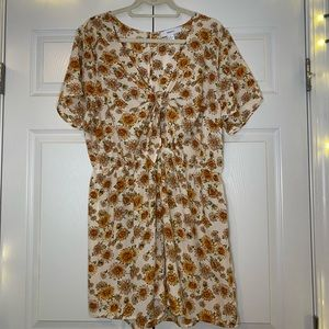 Sunflower printed romper with a tied front